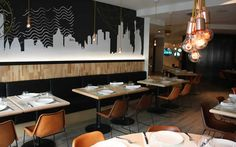 I really like the skyline wall. Restaurant Interiors, House Restaurant, Restaurant Ideas, Restaurant Design, Outside Seating Area, Seating Areas, Retail Image, Opening A Cafe, Cosy Cafe