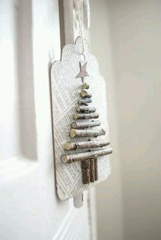 Want to make rustic xmas ornaments for my woodland theme next yr. use old paper, dried twigs, and a bit of ink, to create these cute recycled paper twiggy tags! Great for hanging on the Christmas tree or using for tags. Wooden Christmas Trees, Noel Christmas, Christmas Gift Tags, Rustic Christmas, All Things Christmas, Winter Christmas, Christmas Decorations, Christmas Ornaments, Natural Christmas