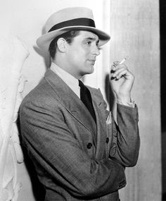 A portrait of Cary Grant taken in 1936. We love his french cuff shirt and double-breasted coat.