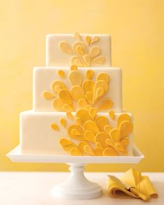 Teardrop Wedding Cake with fondant cutouts in ombre yellow.