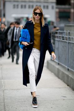 Winter Outfits; Mustard knit, Navy Coat and White Jeans with Statement Fluffy Bag