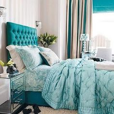 Double up the aqua & teal on the bed for more impact.