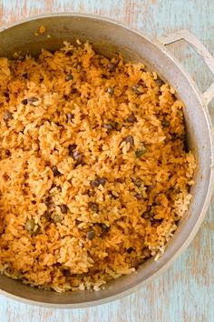 Puerto Rican Rice - Arroz con gandules - Puerto Rican Rice with Pigeon Peas. Seriously the best rice you've ever had!