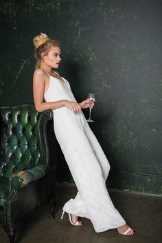 With super sexy straps, subtle wide trouser legs and nipped in at the waist, this beautiful bridal jumpsuit is handmade in London. Alternative Wedding Dresses, Alternative Bride, Top Wedding Trends, Wedding Styles, Wedding Ideas, Wedding Stuff, Wedding Inspiration, Wedding Jumpsuit, Homecoming Jumpsuit