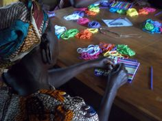 The widows at the Widow Care Center in Kenya making potholders.