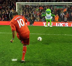 John Barnes takes a penalty in the Seeing is Believing challenge at Anfield