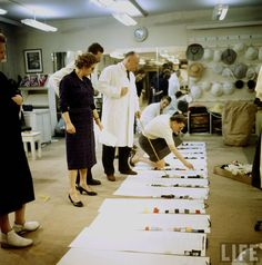 Dior viewing Fabrics Picture by Loomis Dean 1957