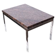Granite And Chrome Coffee Table  USA  1970's  A mid century modern rectangular coffee table with a chrome base and rose granite top.
