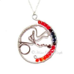 In the Womb, Wire Abstract Pendant- Pregnancy, Birth, Midwife, Doula, Mother, Baby, Fetus. $45.00, via Etsy.