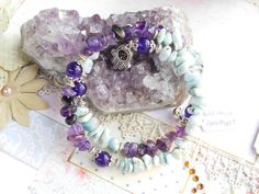 Bracelet memory wired w/ Larimar and Amethyst stones and silver accents by…