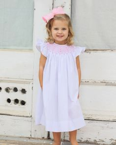 Classic white bishop-length dress with pink smocking on the top. Angel sleeves and button closure at neck. Low Key Wedding Dress, Sexy Wedding Dresses, Girls Smocked Dresses, Flower Girl Dresses, Flower Girls, Easter Dress, Smock Dress, Toddler Fashion, Smocking