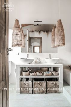 How to accessorise your bathroom with rustic storage solutions, reed baskets and woven lamps
