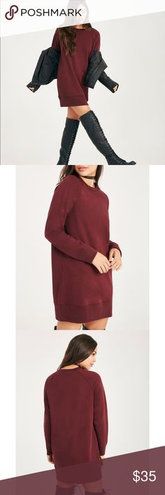 "• Maroon Crewneck Sweater Dress • The comfort of this sweater dress is the best! It's an oversized fit sweater dress in a maroon shade. This comfy and casual sweatshirt dress features a French terry knit body, raglan sleeves, banded ribbed knit trim, and a relaxed fit.  • Model is 5'7"" and wears a size small. • Crew Neckline • Long Sleeves • Pull-on Construction • Unlined • 32"" From Shoulder to Hem • Polyester / cotton Sweaters Crew & Scoop Necks"
