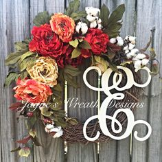Grapevine Wreath with Peonies, cotton bolls and vine script letter. Great for fall or as an all year wreath. By Jayne's Wreath Designs on fb and Instagram.