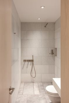 """How a Simple Bathroom Renovation Turned Into an Entire Apartment Overhaul: Night and day! The small bathroom, which originally had dark tiles, has been converted into a bright, open wet room. """"David knew he wanted a Japanese bidet toilet and the Scandinav Ada Bathroom, Mold In Bathroom, Office Bathroom, Small Bathroom Storage, Upstairs Bathrooms, Bathtub, Bathroom Ideas, Simple Bathroom, Bathroom Closet"""