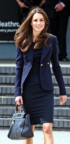 Where:At Heathrow airport for a flight to Canada on her first Royal tour.  What:Dress by Roland Mouret, jacket by Smythe, bag by Mulberry.