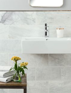 Introduce a brass tile trim which will age over time creating an organic aged look