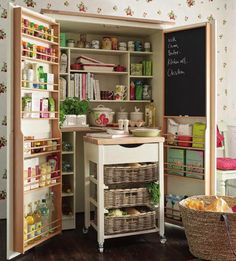 rustic Kitchen by Laura Ashley Decoración. Super efficient kitchen pantry and spice rack in this homemade shelving unit Kitchen Cupboard Storage, Larder Cupboard, Kitchen Pantry, Rustic Kitchen, New Kitchen, Kitchen Island, Wall Pantry, Craft Cupboard, Pantry Doors