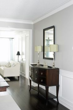 Benjamin Moore Revere Pewter paint. Love the wainscoting + the floors too.