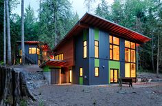 Steel House Siding Prices | This house combines red metal siding, stone, and wooden shingles
