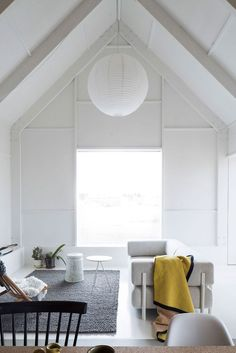 High ceilings to die for, open vistas through the windows, minimalist living space, warm wood, white living space and woven textiles | A Home for an Architect's Mother by Forstberg Ling | Yellowtrace
