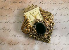 Victorian Inspired Collage Brooch with Black by FromABygoneTime, $30.00       Very cute little brooch.
