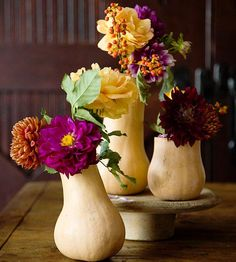 Use gourds as vases for fall flowers. More ideas for #fall #decorating: http://www.bhg.com/halloween/outdoor-decorations/gourds-pumpkins-uses/#page=20