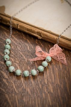 My two FAVORITE colors together!! - Lace bow necklace mint green beads coral pink by DamselofDainty.