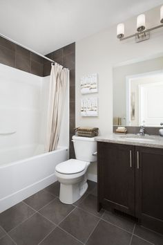 Main bath with light granite counters and dark wood cabinets Light Granite, Dark Wood Cabinets, Granite Counters, Clawfoot Bathtub, Home Builders, New Homes, House Design, Bathroom, Street