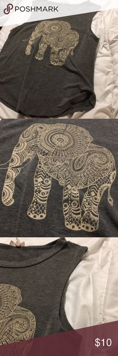 """Elephant print """"muscle tee"""" Gray shirt with a print of an elephant on it. Resembles a muscle tee but doesn't go down as far but covers the shoulders. Ask for modeling pictures and make an offer! I can negotiate and also look through my page to see if a bundle (15% off 3 or more items) would be good for you! If interested please let me know as I am trying to sell everything I can to save for a car and get a job :) thank you! Tops Muscle Tees"""