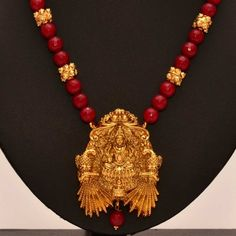 Anvi's lakshmi (temple jewellery) pendent with ruby and gold beads