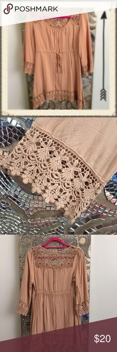 Charming Charlie Lace Tunic size M charming Charlie's tunic, tan/peach in color. Beautiful dainty lace trim and drawstring waiste. Boho chic! Charming Charlie Tops Tunics