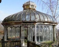 Abandoned Victorian Glasshouse... Cleaned up this would be an awesome place for tea and reading on a rainy day.