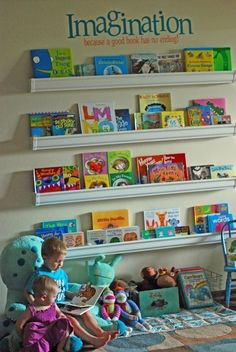 Rain Gutter Bookshelves - I love the idea of having a childrens reading nook in a playroom or family library room. Someday if I have that many rooms in my house. Rain Gutter Shelves, Gutter Bookshelf, Bookshelf Wall, Floating Bookshelves, Toy Shelves, Wall Shelving, Bookshelf Ideas, Ikea Shelves, Shelving Ideas