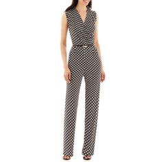 <p>Put your best look forward in our print knit jumpsuit, featuring a skinny belt, flattering surplice neckline and keyhole back.</p><ul><li>back zipper</li><li>29