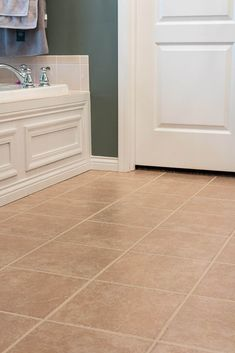 Make your tiled floor look brand new again! This tutorial has the easiest tips and tricks to paint your tile grout with just a few simple steps. Avoid the hassle of cleaning your dirty grout lines and find the best paint products to freshen up your grout. Grout Paint, Tile Grout, Sanded Grout, Powder Room Paint, Grout Repair, Easy Tile, Beige Bathroom, Master Bathroom, Painting Tile Floors