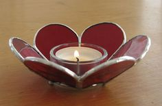 Stained Glass Flower shape canddle holder. $16.00, via Etsy.
