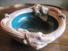 unique clay pottery bowl with beautiful glazed aqua green bowl, lined around the…