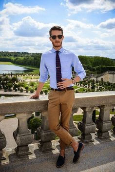 041e8120d0a00 Shop this look on Lookastic  Dark Brown Sunglasses — Light Blue Dress Shirt  — Navy Horizontal Striped Tie — Dark Brown Leather Belt — Brown Chinos —  Black ...