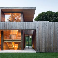 Long Island house by Bates Masi Architects has adjustable sound barriers for…