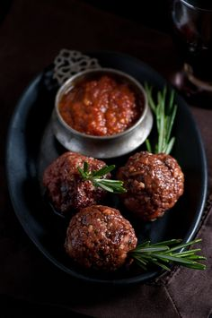 Rosmarin in Culo - a recipe inspired by the famous Tuscan butcher, Dario Cecchini.  Homemade ground beef and pork meatballs served skewered on a sprig of rosemary with homemade sundried tomato ketchup.