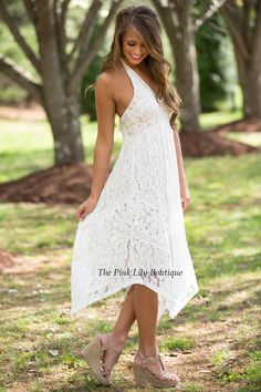 Look like a laced beauty in this gorgeous dress! The intricate white lace detail over the nude lining and flowy look makes it a beautiful dress that's hard to pass up! It also features a halter tie, zipper in the back, and v-neck created by overlapping fabric! Add wedges and you'll have a look everyone will want!
