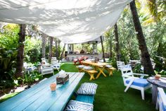 White canvas canopy in Outdoor & Alfresco Dining Room Ideas. A big white canvas canopy hangs above multi-coloured outdoor tables and chairs. Backyard Canopy, Garden Canopy, Patio Canopy, Canopy Outdoor, Canopy Tent, Ikea Canopy, Fabric Canopy, Canopy Lights, Gardens