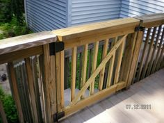 Deck Gates for Dogs | stairs into side yard for dogs concrete pad at bottom of stairs
