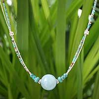 large rd bead with graduated beads and seed bead chain.