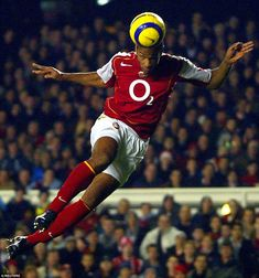 Henry shows his heading prowess with an almost diagonal leap to reach a cross during Arsenal's 3-0 win over Birmingham in 2004
