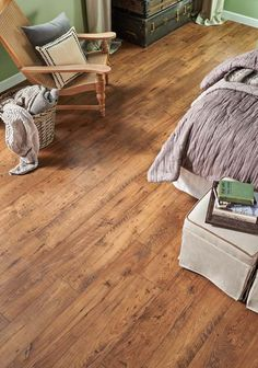 This Pergo Max Premier Amber Oak floor gives this room even more charm and class.