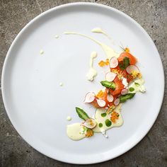 Cured Norwegian salmon, asparagus and radish, cucumber juice and mayonnaise, salmon roe, egg mimosa by @czarneckigreg #GourmetArtistry