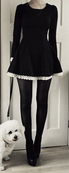 Black dress with white lace trim. Love this as a Wednesday Adams Halloween outfit! #GothicFashion