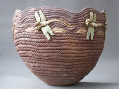 This coil pot is so well constructed I thought it was a basket.